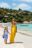 Cute girl and beautiful mother on the beach Royalty Free Stock Image
