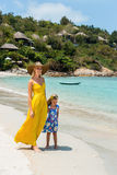 Cute girl and beautiful mother on the beach Stock Photos
