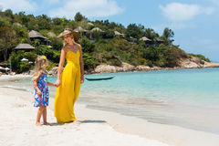 Cute girl and beautiful mother on the beach Royalty Free Stock Photos