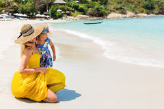 Cute girl and beautiful mother on the beach Stock Image