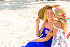 Cute girl and beautiful mother on the beach Royalty Free Stock Photography