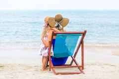 Cute girl and beautiful mother on the beach Stock Photo