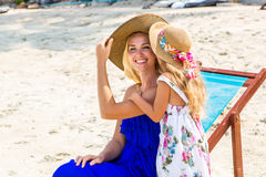 Cute girl and beautiful mother on the beach Stock Photography