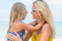 Cute girl and beautiful mother on the beach Stock Images