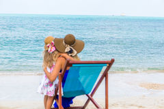 Cute girl and beautiful mother on the beach Royalty Free Stock Photo