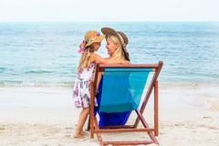 Cute girl and beautiful mother on the beach Royalty Free Stock Images