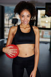 Cute girl with a beautiful smile keeps the ball for Pilates Royalty Free Stock Photo
