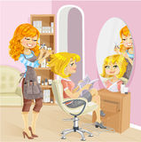 Cute girl in a beauty salon at the hairdresser Royalty Free Stock Photography