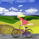 Cute girl on bicycle Royalty Free Stock Photography