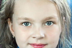 Cute girl with big blue eyes Royalty Free Stock Photo