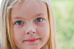 Cute girl with big blue eyes Royalty Free Stock Images
