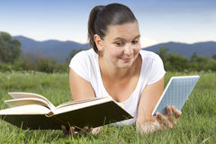 Cute girl in big dilemmae-book or old book Royalty Free Stock Photo