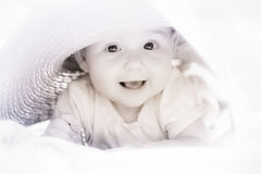 Cute girl in big hat Royalty Free Stock Images