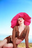 Cute girl in a big red hat  sea Stock Photography