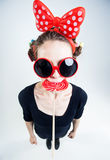 Cute girl with a big red lollipop and funny sunglasses Stock Photography