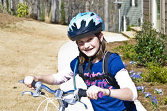 Cute Girl on a Bike Royalty Free Stock Photos