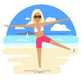 Cute girl in a bikini and pareo on the beach. Stock Photography
