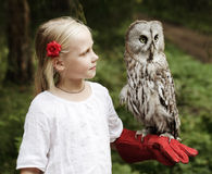 Cute girl with bird. Outdoors Royalty Free Stock Photography