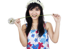 Cute girl biting flower isolated Royalty Free Stock Photo
