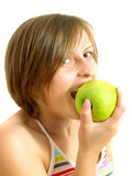 Cute girl biting a green apple Stock Photo