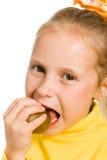 Cute girl biting an kiwi Stock Image