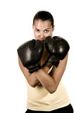 Cute girl in black boxing gloves. Isolated - sepia toned image Royalty Free Stock Photography