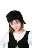 Cute girl in black and white clothing. With big eyes and sideways hat royalty free stock photos