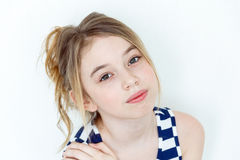 Cute girl with blond long hair. Cute girl eleven years old with blond long hair and big eyes on white stock photography