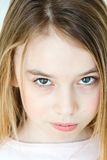 Cute girl with blond long hair. Cute girl eleven years old with blond long hair and green eyes stock photography