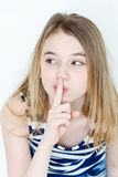Cute girl with blond long hair. Portrait of girl eleven years old with big green eyes says quiet stock image