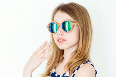 Cute girl with blond long hair. Portrait of blond girl in green sunglasses on white royalty free stock photos