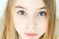 Cute girl with blond long hair. Sad girl eleven years old with blond long hair and green eyes royalty free stock images