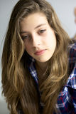 Cute girl with blond long hair thinking Stock Image