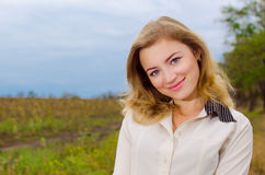 Cute girl. Cute blondie girl smiling outdoor Stock Images
