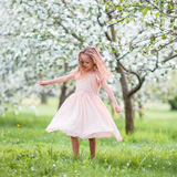 Cute girl in blooming apple tree garden enjoy the warm day Royalty Free Stock Photography