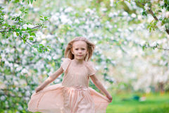 Cute girl in blooming apple tree garden enjoy the warm day Royalty Free Stock Photo