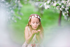 Cute girl in blooming apple tree garden enjoy the warm day Royalty Free Stock Photos