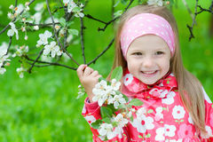 Cute girl with blossoming apple tree Royalty Free Stock Images