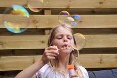 Cute girl blowing bubbles Stock Image