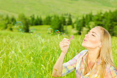 Cute girl blowing bubbles outdoors Stock Photography