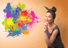 Cute girl blowing colorful splash graffiti Stock Photography