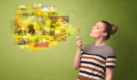 Cute girl blowing colourful glowing memory picture concept Royalty Free Stock Photo