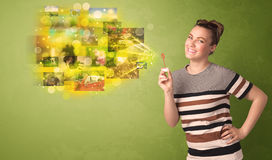 Cute girl blowing colourful glowing memory picture concept Stock Image