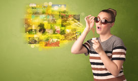 Cute girl blowing colourful glowing memory picture concept Royalty Free Stock Photos