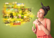 Cute girl blowing colourful glowing memory picture concept Stock Photo