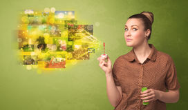 Cute girl blowing colourful glowing memory picture concept Royalty Free Stock Photography