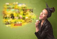 Cute girl blowing colourful glowing memory picture concept Royalty Free Stock Image