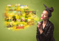 Cute girl blowing colourful glowing memory picture concept Stock Images