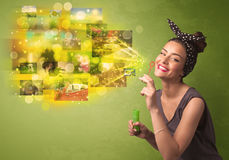 Cute girl blowing colourful glowing memory picture concept Stock Photography