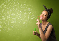 Cute girl blowing hand drawn media icons and symbols Stock Photography